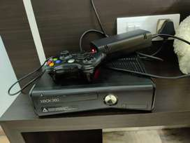 Xbox 360 slim edition with 25 games and 3 remote controls