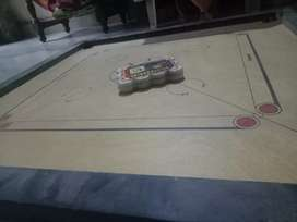 Carrom board available with tournament coins
