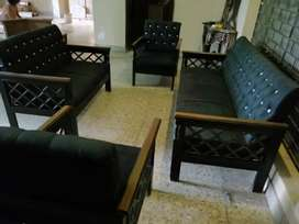 Sofa in black cloth with shishem frame solid