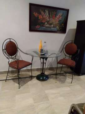 Set of a table and two chairs made of (Wrought Iron).