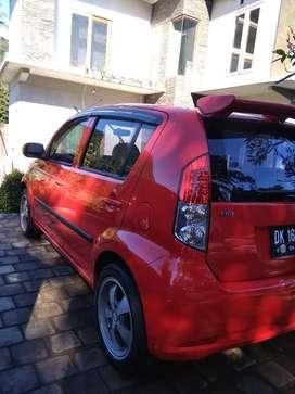 Daihatsu sirion 2007 merah apa adanya