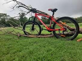 Tata Harris 100. 21 gear cycle with lifetime frame warranty.