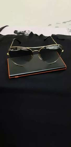 Rayban sun glasses gold for day and night.