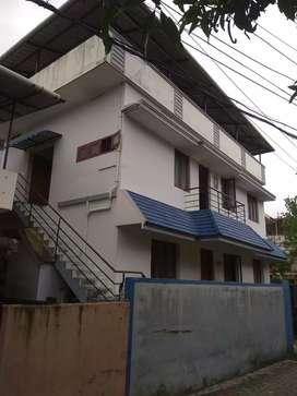(BACHELORS 3 NOS) 1 bhk first floor house rent Kaloor.