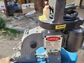 Capital bag closure machine self-lubricating