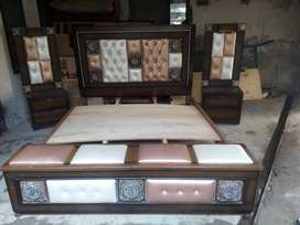Bed set with spring matress side table and dressing.