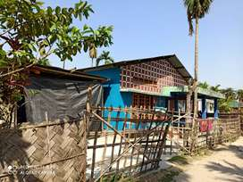 Land with house tezpur solmara road near army gate...