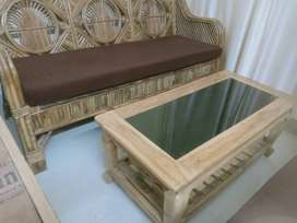 Sofa with center table and queen size Bed