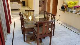 Dining table ( six seater  teak wood) with glass top