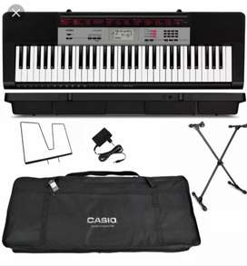 Casio keyboard with full Accessories