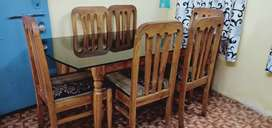 Dining is of  wood ( sagon). Six sitter.
