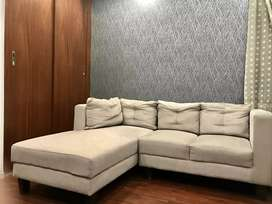 11 months old 4 seater beige colour sectional sofa for sale