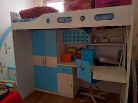 Bunk bed with study table and cupboard