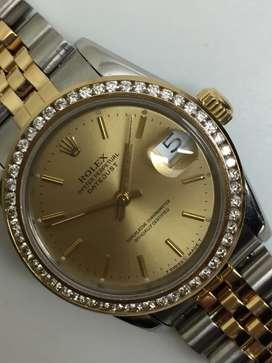 Rolex boysize 18KSS diamonds bezel champagne dial.