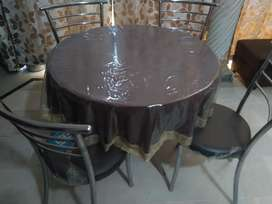 Round table with four chairs in almost new condition for sale.