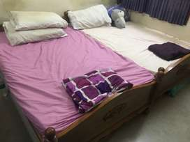10 year old solid wood cot with spring mattress