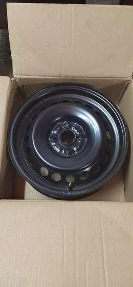 New 15 inch baleno wheels and new Suzuki wheel cap for sale