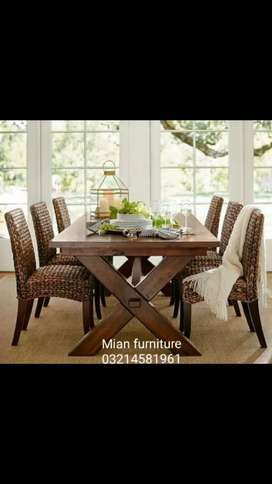 Elegant Dining wooden top with six full poshish Chairs