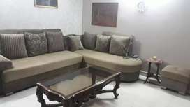 5 seater L shaped comfortable sofa with free puffy and pillows.