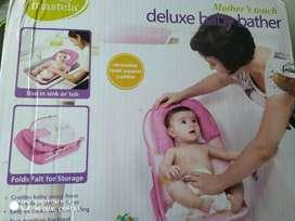 Deluxe Baby bather totally unused