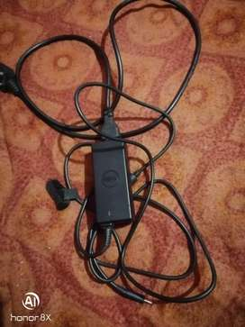 Dell laptop charger 45w. New condition serious buyers call me