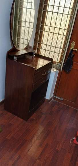Sturdy dressing table with two drawers and book rack