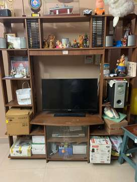 Television stand with racks for placing other decorative items