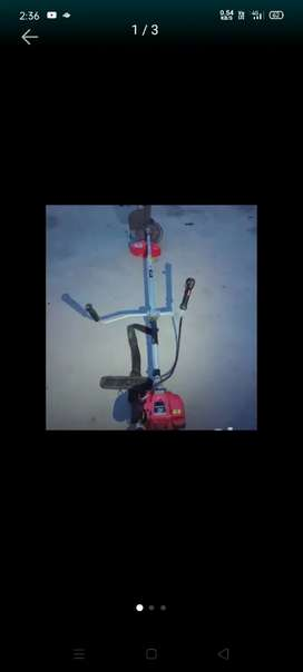Grass cutter machine with paddy guard and blade