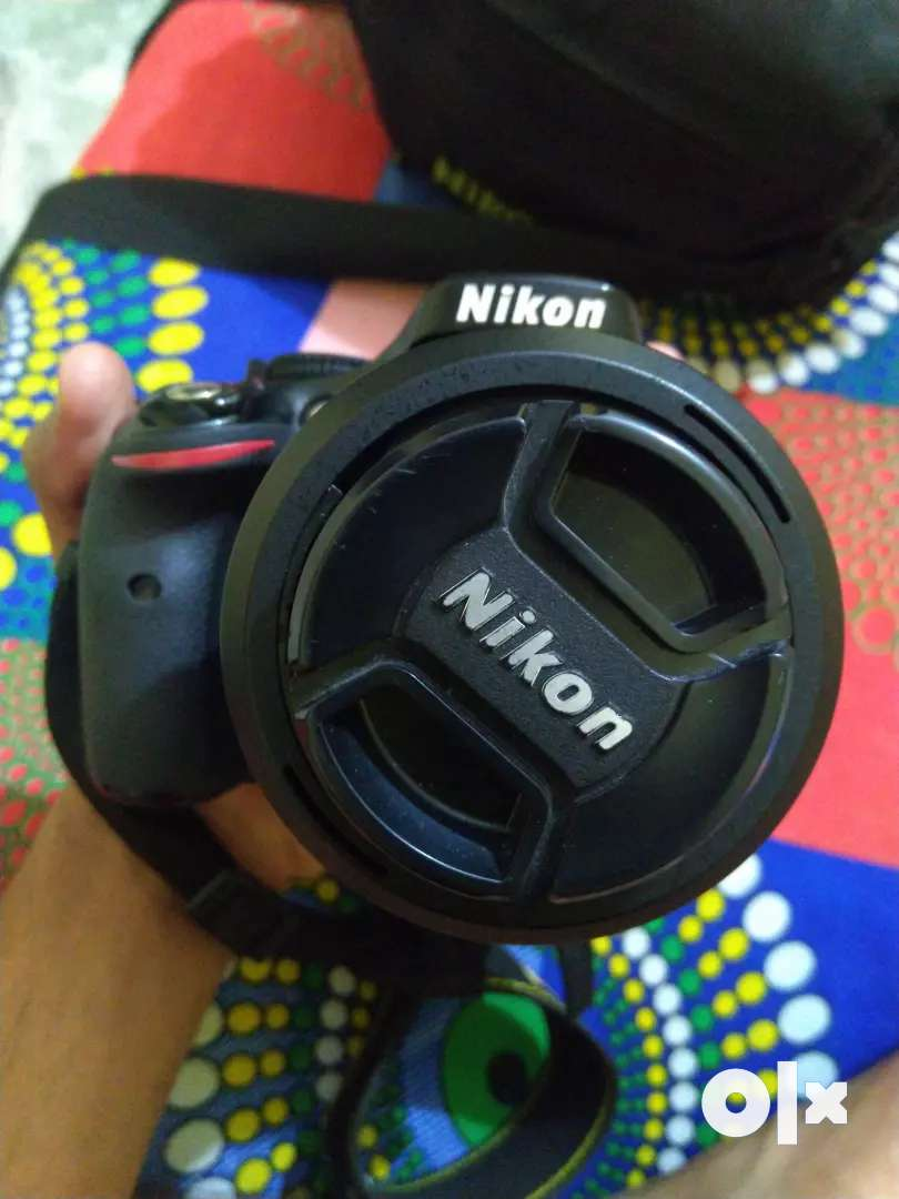 NIKON D5200 CAMERA + NIKON 35MM LENS 0