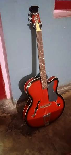 Good condition guitar with pick and capo