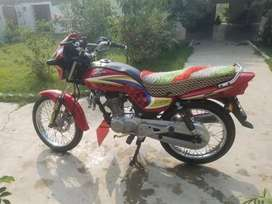 Honda delux 125. Red colour.good new condition