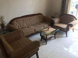 Wooden sofa set with matching chairs of dinning
