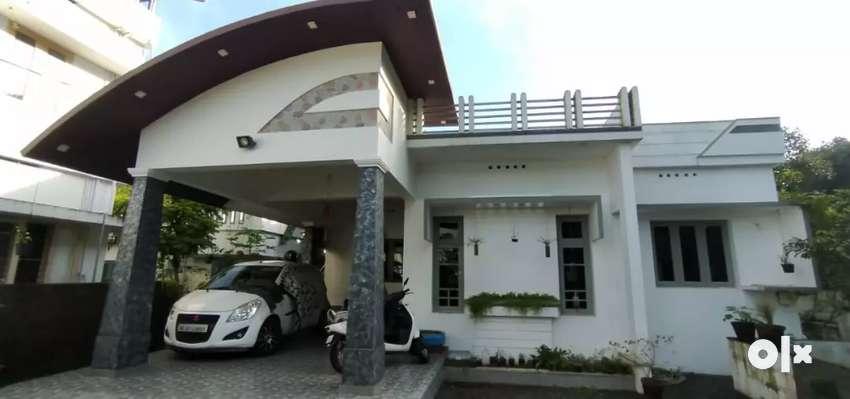 6.7 cent 1300 sqft 3 bhk house at aluva kalamassery road kombara 0