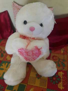 it is a soft toy of white and pink in colour.it
