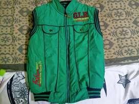 Green color half Tibet woolen jacket for kids.