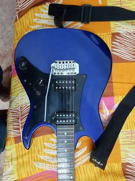 Ibanez GIO electric guitar and Roland Cube amplifier