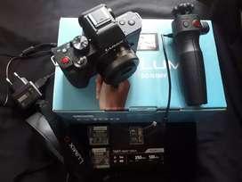 Panasonic lumix DC-G100V with 12-32 mm + tripod grip kit + 2 batrre