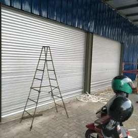 Rolling door polding gate