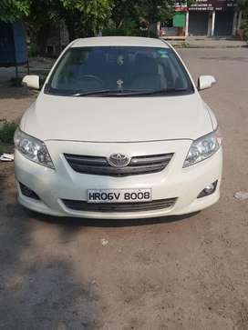 Well maintained and single hand driven corolla altis fitted with cng