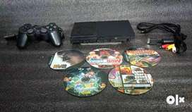 PS2 WITH 5 DVD 1 REMOTE ALL ACCESSORIES