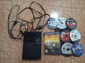 PS2 with sony controllers and game CDs