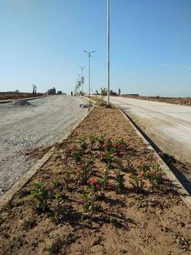 ALL DUES CLEAR MAIN ROAD 1 KANAL PLOT FOR SALE IN DHA 9 PRISM GG