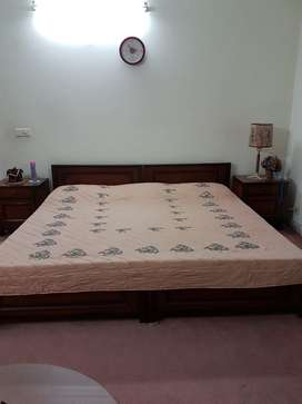 Two single beds with side tables