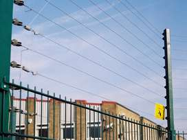 Electric fences for boundary wall security system