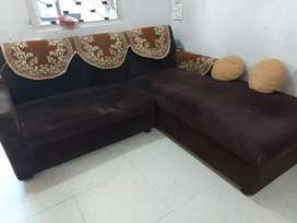 L shaped sofa with 2 small round pillows