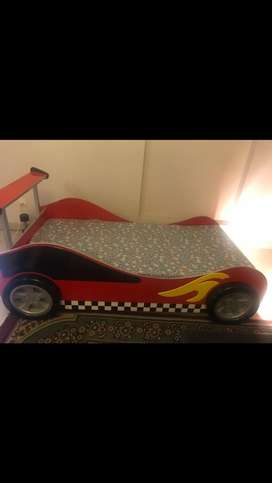 Blue and red car beds each for Rs 25000
