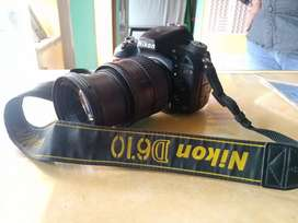 Nikon 610.. camara. 24.85 nikon lence.
