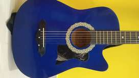 Fully fubctional rarely used shining blue guiter at affordable price