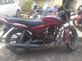 Wine red CB Honda shine in perfect condition.