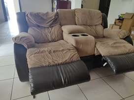 Double seater recliner with cup holders